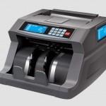Mesin Hitung Merek DE LA RUE Memudahkan Proses Transaksi
